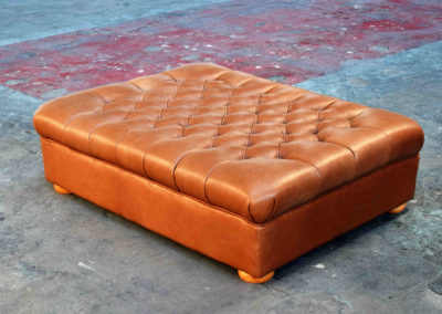 Deep buttoned leather Ottoman